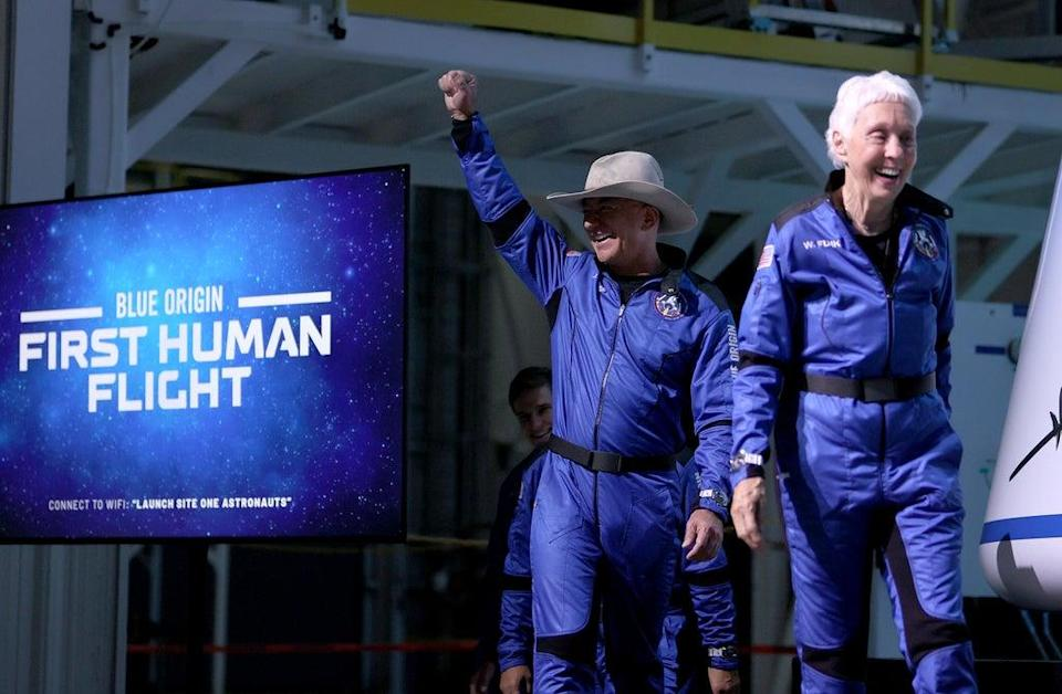 Blue Origin's New Shepard crew (L-R) Jeff Bezos and Wally Funk arrive for a press conference after flying into space in the Blue Origin New Shepard rocket (Getty Images)