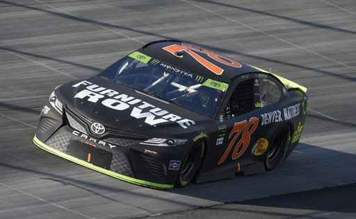 FILE - In this Oct. 1, 2017, file photo, Martin Truex Jr. competes during the NASCAR Cup Series auto race, at Dover International Speedway in Dover, Del. Furniture Row Racing will cease operations at the end of this season, shutting its doors one year after Martin Truex Jr. won NASCARs championship driving for the maverick race team. Furniture Row is an anomaly in NASCAR in that it is a single-car team based in Denver, Colorado, far removed from the North Carolina hub. Team owner Barney Visser was a racing enthusiast with a vision when he launched the team in 2005 determined to do it his own way. But a lack of sponsorship for next season led Visser to make the painful decision to close the team. (AP Photo/Nick Wass, File)