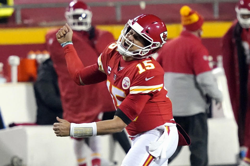 FILE - In this Sunday, Jan. 24, 2021, file photo, Kansas City Chiefs quarterback Patrick Mahomes celebrates after throwing a 5-yard touchdown pass to tight end Travis Kelce during the second half of the AFC championship NFL football game against the Buffalo Bills in Kansas City, Mo. The Super Bowl matchup features the most accomplished quarterback ever to play the game who is still thriving at age 43 in Brady against the young gun who is rewriting record books at age 25. (AP Photo/Jeff Roberson, File)