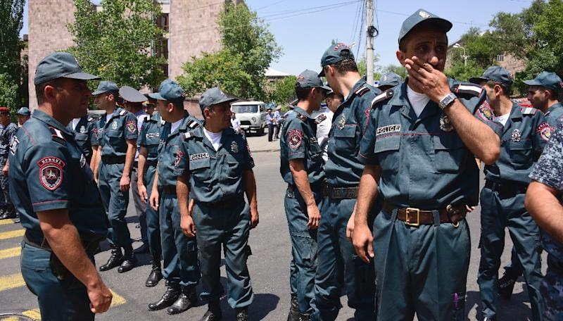 Armenian police officers block the streets to Erebuni police station in Yerevan on July 17, 2016, after gunmen seized a police building and hostages