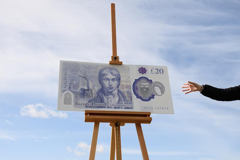 MARGATE, ENGLAND - OCTOBER 10: A large scale sample of the new twenty pound note is seen during the launch event for the new note design at the Turner Contemporary gallery on October 10, 2019 in Margate, England. The new twenty pound note will be made of polymer rather than paper, also the current portrait of scottish economist Adam Smith on the obverse, will be replaced with one of english artist J.M.W Turner. The new note will start to enter circulation in 2020 as the older note is gradually phased out. (Photo by Leon Neal/Getty Images)