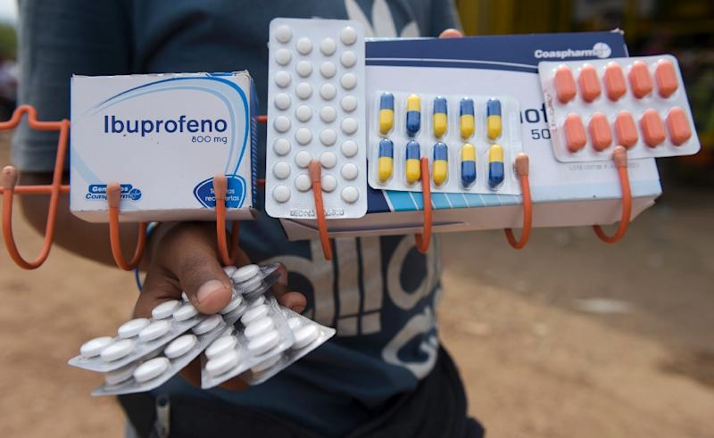 A man sells pain-relievers in Cucuta, Colombia, across the border from Venezuela, where medications are in desperately short supply (AFP Photo/Raul ARBOLEDA)