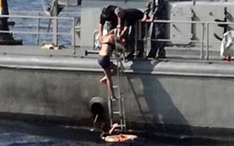 Kay is helped aboard the Croatian Coast Guard ship Cavtat