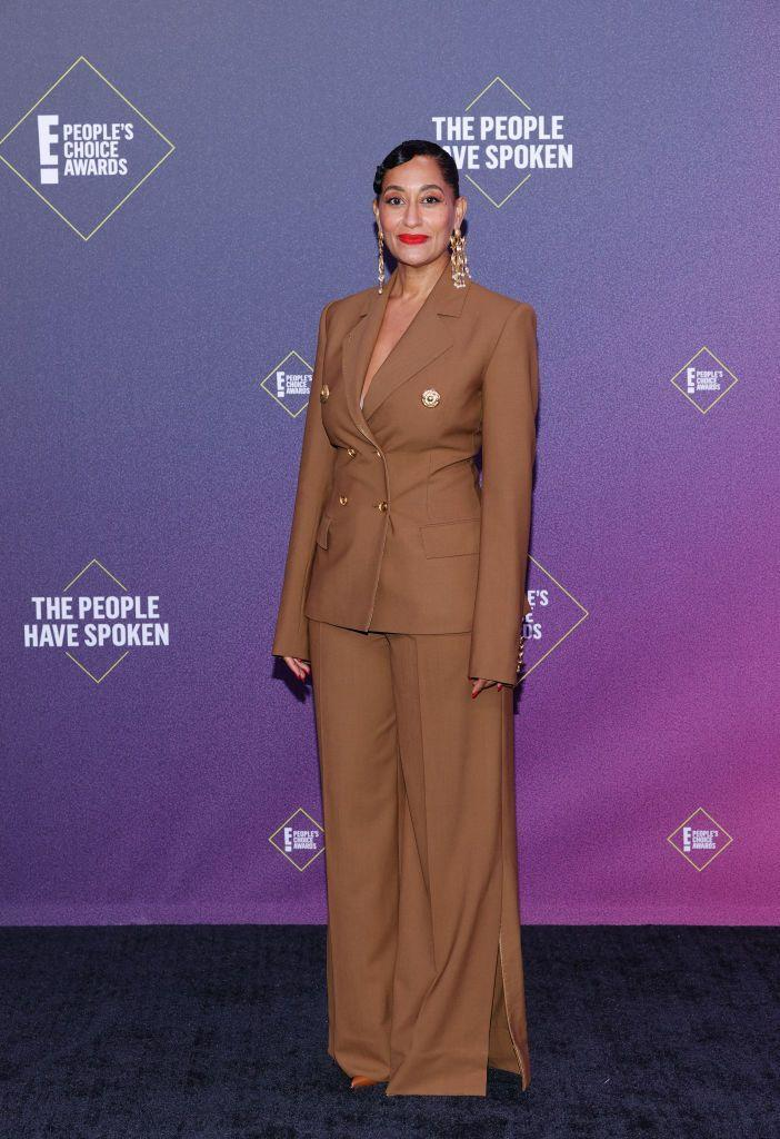 <p>As she was picking up the Fashion Icon accolade at the awards, the pressure was on Tracee Ellis Ross on the red carpet, and she certainly delivered. The actress opted for a brown wide-legged trouser suit by Schiaparelli, which she wore bare underneath and teamed with some statement earrings. Ellis Ross later changed into another statement look in the form of a white shirt dress with thigh-high leather boots by Alexander McQueen.</p>