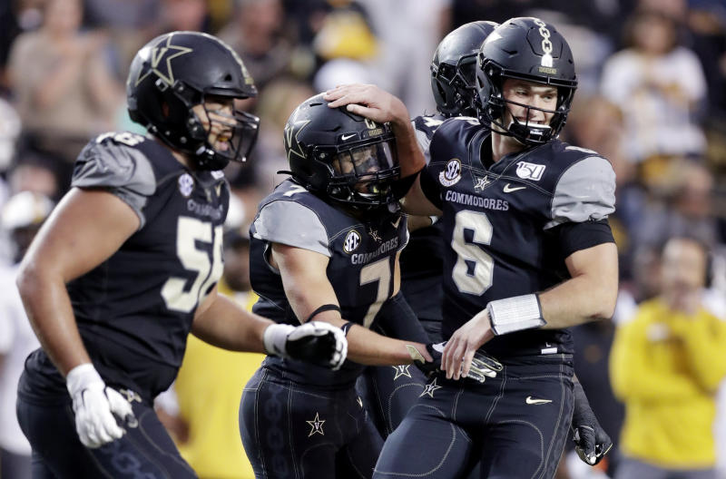 Vanderbilt wide receiver Cam Johnson (7) is congratulated by quarterback Riley Neal (6) after they teamed up for the winning touchdown on a 21-yard pass play against Missouri in the second half of an NCAA college football game Saturday, Oct. 19, 2019, in Nashville, Tenn. Vanderbilt upset Missouri 21-14. (AP Photo/Mark Humphrey)