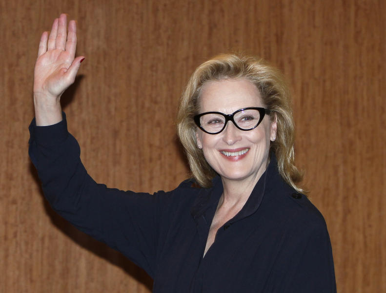 """FILE - In this March 7, 2012 file photo, Academy Award winning actress Meryl Streep waves during a press conference to promote their movie """"The Iron Lady"""" in Tokyo, Japan. Last weekend Streep, along with Secretary of State Hillary Rodham Clinton participated the Women in the World summit, a three-day gathering prominent women leaders. (AP Photo/Shizuo Kambayashi)"""