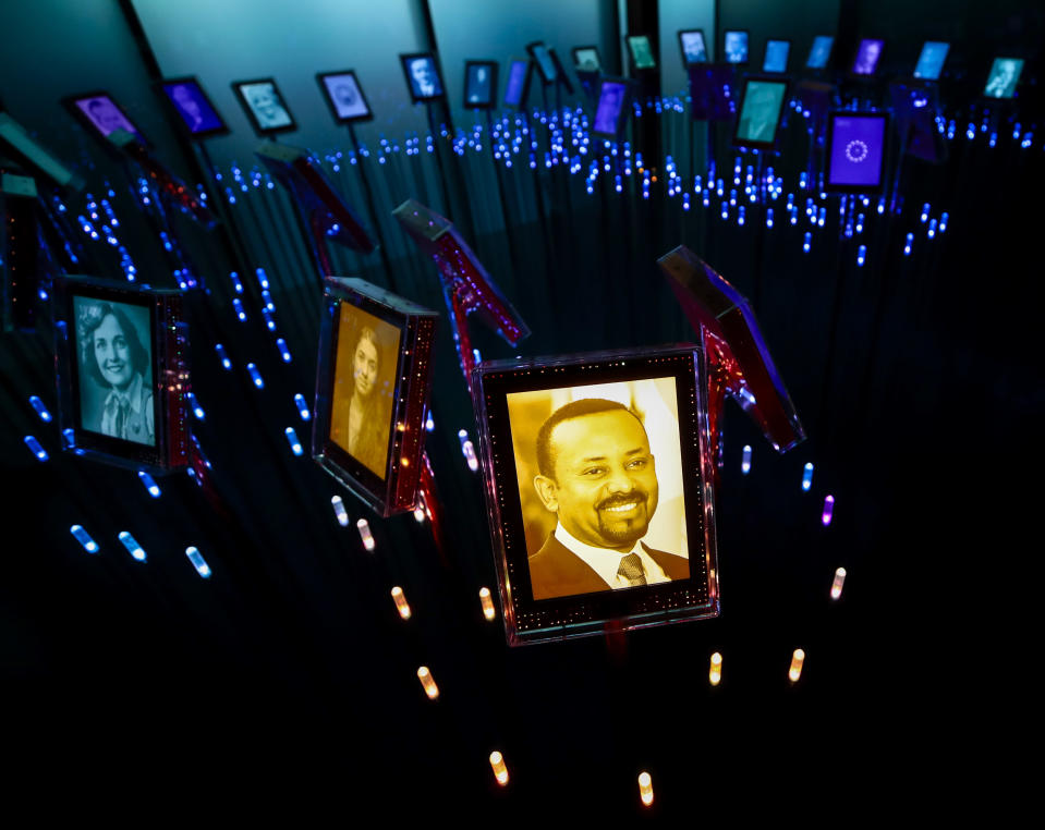 """FILE - In this Friday, Oct. 11, 2019, file photo, a photograph of Ethiopian Prime Minister Abiy Ahmed, who was awarded the Nobel Peace Prize, is displayed with past Nobel Peace Prize winners, in their own """"garden"""" at the Nobel Peace Center in Oslo, Norway. Ahmed left Ethiopians breathless when he became the prime minister in 2018, introducing a wave of political reforms in the long-repressive country and announcing a shocking peace with enemy Eritrea. Now, Abiy is waging war in the defiant Tigray region. (Lise Aserud/NTB Scanpix via AP, File)"""