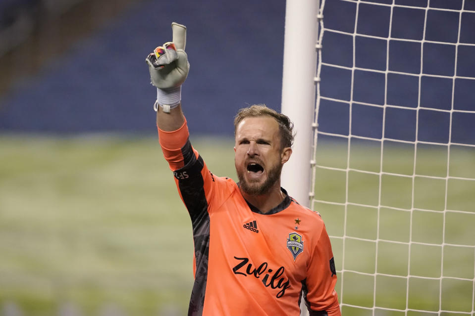 Seattle Sounders goalkeeper Stefan Frei lets out a yell after the team's 3-1 win over Los Angeles FC in an MLS playoff soccer match Tuesday, Nov. 24, 2020, in Seattle. (AP Photo/Ted S. Warren)