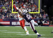 New England Patriots linebacker Dont'a Hightower (54) pressures Kansas City Chiefs quarterback Patrick Mahomes (15) as he tries to pass during the first half of an NFL football game, Sunday, Oct. 14, 2018, in Foxborough, Mass. (AP Photo/Steven Senne)