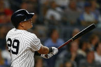 New York Yankees' Gio Urshela follows through on a two-run home run during the third inning of a baseball game against the Boston Red Sox, Sunday, Aug. 4, 2019, in New York. (AP Photo/Adam Hunger)