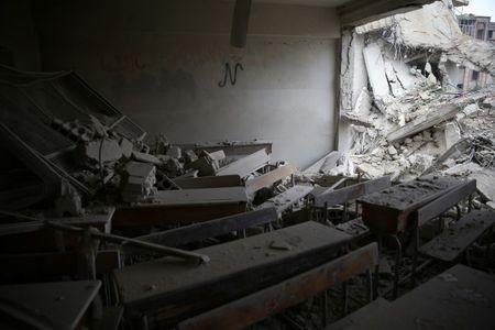 A damaged classroom is pictured in the rebel held besieged city of Douma, in the eastern Damascus suburb of Ghouta