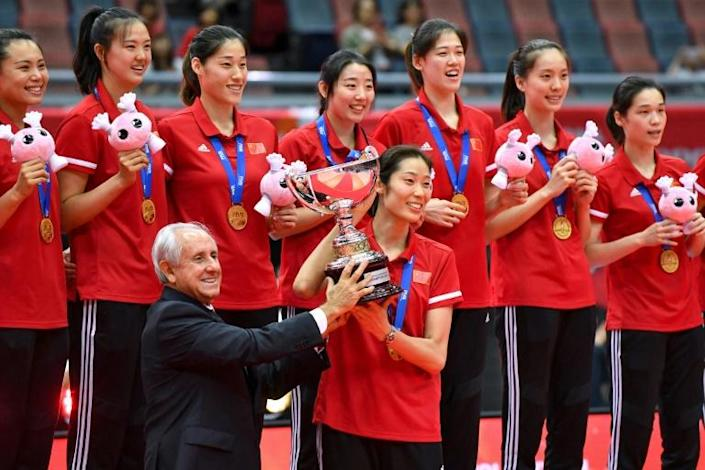 China's captain Zhu Ting holds the trophy at the 2019 World Cup in Osaka