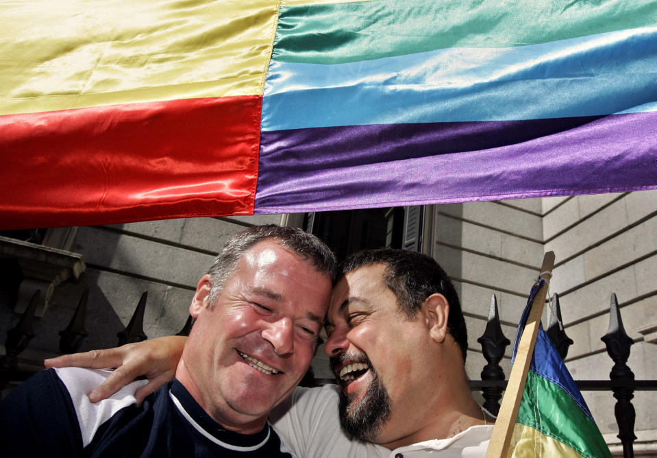 Supporters of gay marriage celebrate under the gay flag outside the Spanish parliament in Madrid, Thursday, June 30, 2005. The parliament has legalized same-sex marriage, defying conservatives and clergy who opposed making traditionally Roman Catholic Spain the third nation to take this step. (AP Photo/Jasper Juinen)