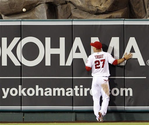 Los Angeles Angels center fielder Mike Trout watches a home run by the Tampa Bay Rays' Evan Longoria sail over the fence in the fifth inning of a baseball game in Anaheim, Calif., Thursday, Aug. 16, 2012. (AP Photo/Reed Saxon)