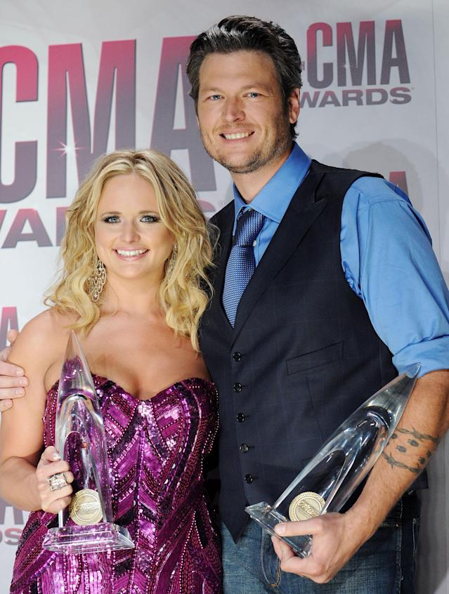 Lambert and Shelton with vocalist of the year trophies they won at the 2011 CMA Awards. (Photo: Jon Kopaloff/FilmMagic)