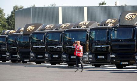 FILE PHOTO: Vehicles of United Parcel Service are seen at the new package sorting and delivery UPS hub in Corbeil-Essonnes and Evry, southern Paris, France, June 26, 2018.  REUTERS/Charles Platiau