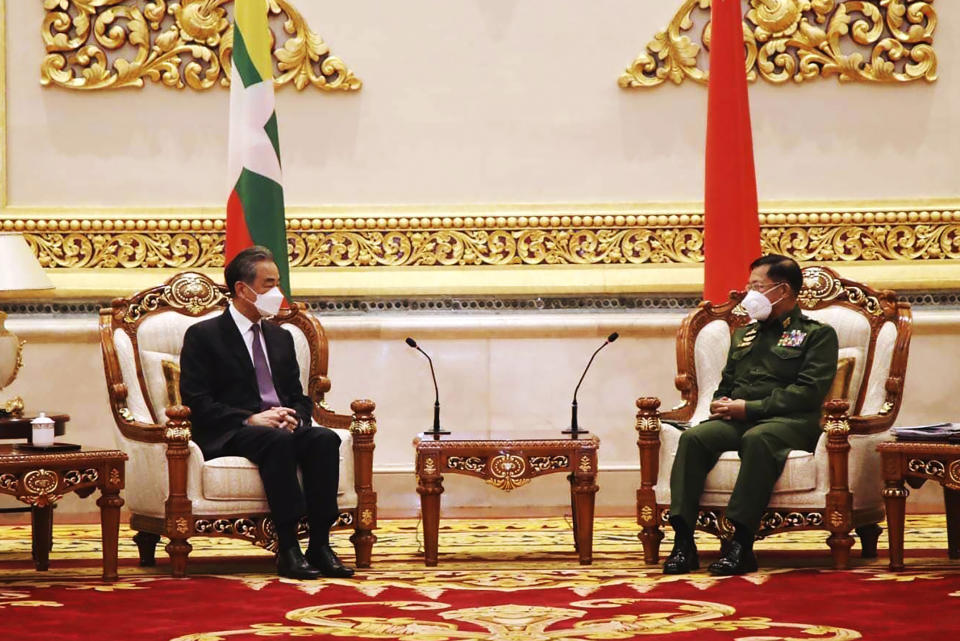 Myanmar's Army Commander Senior Gen. Min Aung Hlaing, right, talks with Chinese Foreign Minister Wang Yi during their meeting in Naypyitaw, Myanmar, Tuesday, Jan. 12, 2021. (Myanmar Military Information Team via AP)
