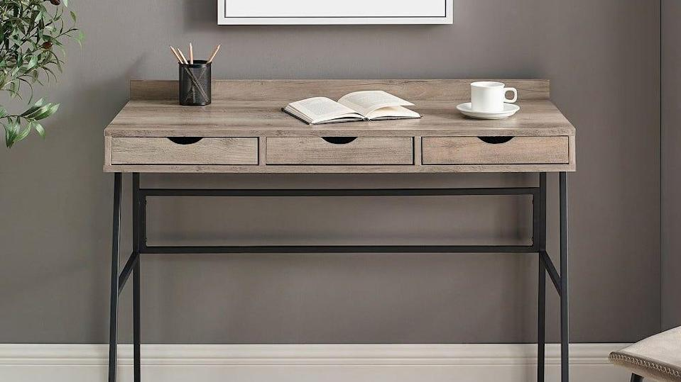At a comfortable 42-inches long, this Carbon Loft writing desk can fit into most home offices.