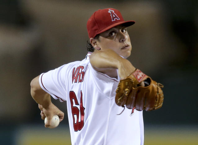 Los Angeles Angels starting pitcher Jason Vargas throws to the Oakland Athletics during the first inning of a baseball game in Anaheim, Calif., Tuesday, Sept. 24, 2013. (AP Photo/Chris Carlson)