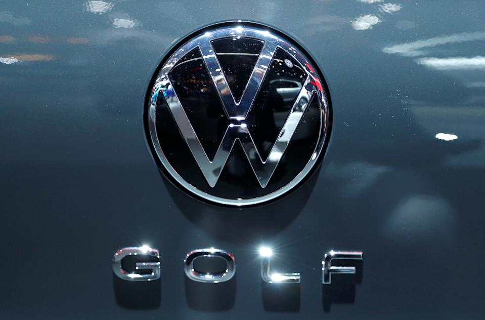 The logo of German carmaker Volkswagen is seen on a new Golf car
