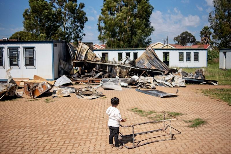 A young member of the 'Coloured' community stands in the courtyard of Oakdale Secondary School in Eldorado Park, on the outskirts of Johannesburg. Several classrooms were destroyed during a student strike in April (AFP Photo/Michele Spatari)