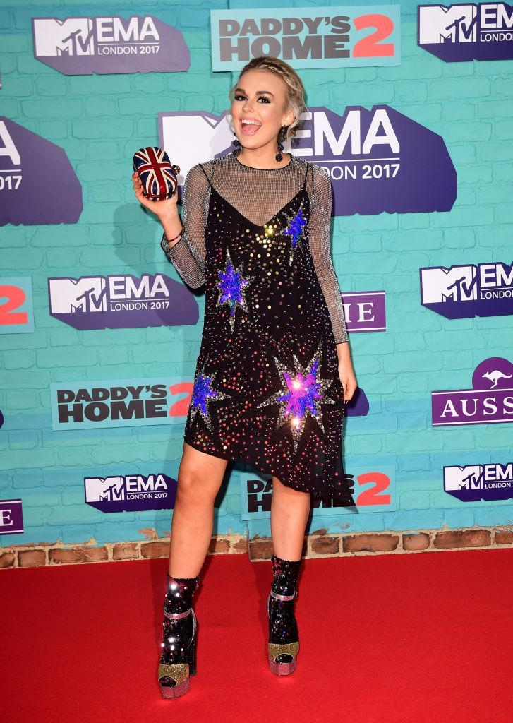 <p>Tallia Storm donned a bejewelled nineties-inspired slip dress over a sheer top for the awards night. She accessorised with glittery platforms and some seriously sparkly socks. (Photo: Getty Images) </p>