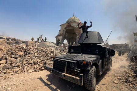An armoured fighting vehicle of the Counter Terrorism Service is seen at the Grand al-Nuri Mosque at the Old City in Mosul, Iraq, June 30, 2017. REUTERS/Alaa Al-Marjani