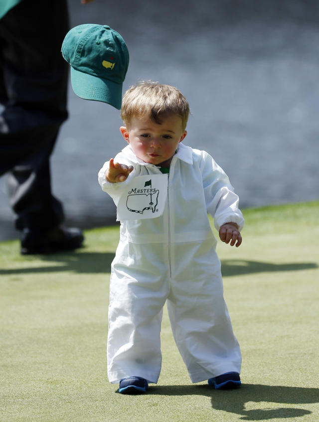 Scott Stallings's son Finn throws off his cap on the fourth green during the par three competition at the Masters golf tournament Wednesday, April 9, 2014, in Augusta, Ga. (AP Photo/Matt Slocum)