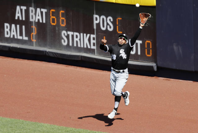 Chicago White Sox right fielder Leury Garcia (28) leaps for a run-scoring sacrifice fly hit by New York Yankees' Kyle Higashioka during the seventh inning of a baseball game, Saturday, April 13, 2019, in New York. The Yankees' Greg Bird scored on the play. (AP Photo/Kathy Willens)