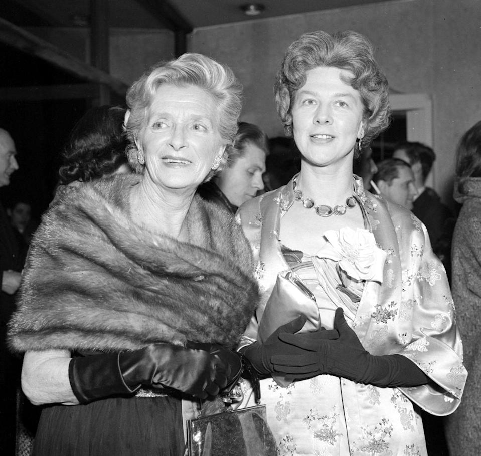 <p>Even in Cooper's final years, her hair was always perfectly set and she was always dressed to the nines. Shown here in 1967 with actress Wendy Hiller, the pair is celebrating after being appointed Dame Commanders of the Order of the British Empire.</p>