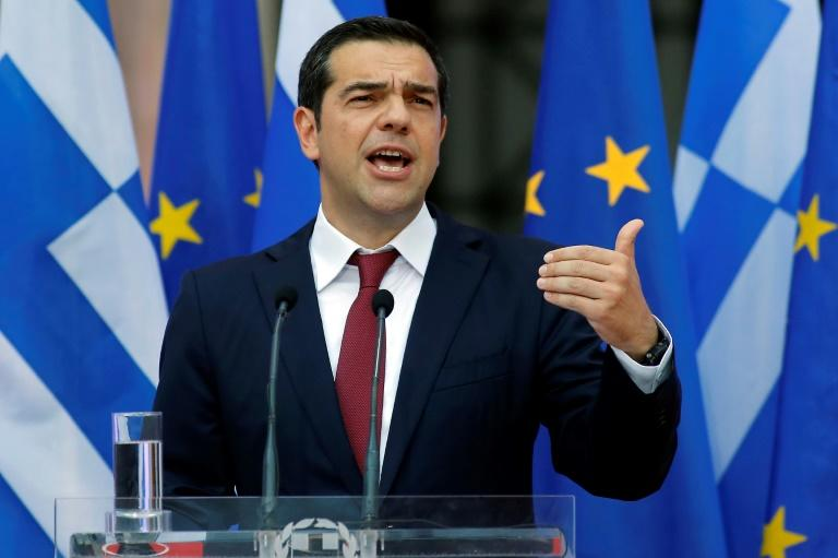 Greek Prime Minister Alexis Tsipras announced his country was 'turning a page' after eurozone ministers declared its crisis over in June