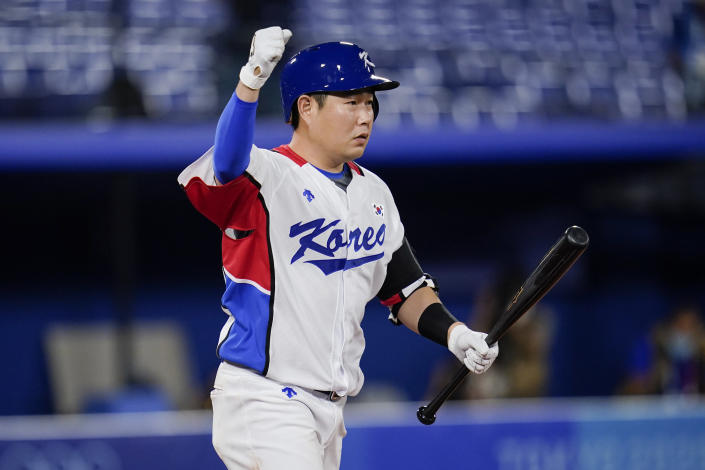 South Korea's Euiji Yang reacts after being hit by pitch to walk in the winning run during the tenth inning of a baseball game against Israel at the 2020 Summer Olympics, Thursday, July 29, 2021, in Yokohama, Japan. South Korea won 6-5.(AP Photo/Sue Ogrocki)