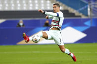 FILE - In this Sunday, Oct. 11, 2020 file photo Portugal's Cristiano Ronaldo stretches for the ball during the UEFA Nations League soccer match between France and Portugal at the Stade de France in Saint-Denis, north of Paris, France. The Portuguese soccer federation says Cristiano Ronaldo has tested positive for the coronavirus. The federation says Ronaldo is doing well and has no symptoms. He has been dropped from the country's Nations League match against Sweden on Wednesday. (AP Photo/Thibault Camus, File)