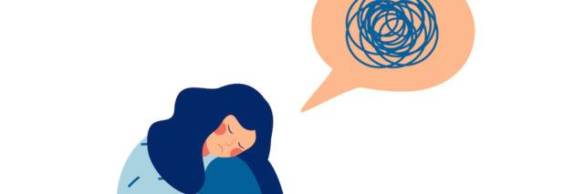 Illustration of a woman sitting, curled into a ball. Next to her head is a speech bubble with scribbles in it.