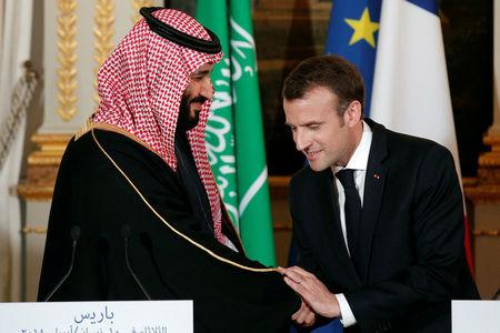 French President Emmanuel Macron and Saudi Arabia's Crown Prince Mohammed bin Salman attend a press conference at the Elysee Palace in Paris, France, April 10, 2018.  Yoan Valat/Pool via Reuters
