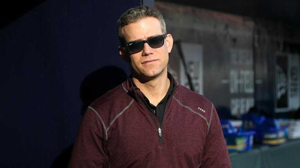 Theo Epstein in dugout wearing sunglasses facing forward in 2019