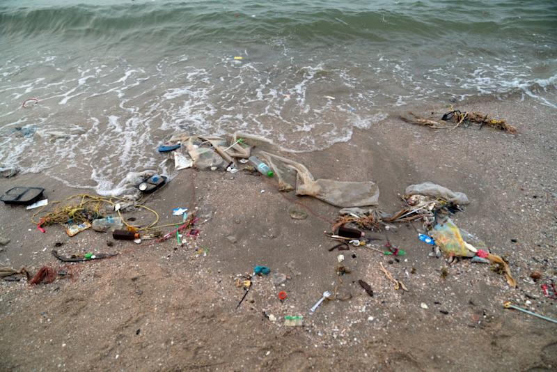 Trash sits along the shore at Bangsaen beach in Chon Buri, Thailand, on Sunday, Jan. 19, 2020. Thailand's love of plastic bags helped make it thesixth-worstmaritime polluter. The country generates more than 5,000 metric tons of plastic trash a day, three-quarters of which ends up in landfills. Photographer: Nicolas Axelrod/Bloomberg