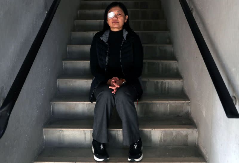 Indonesian journalist Veby Mega Indah, whose right eye was severely injured by Hong Kong police during a protest, poses for a portrait in Hong Kong, China