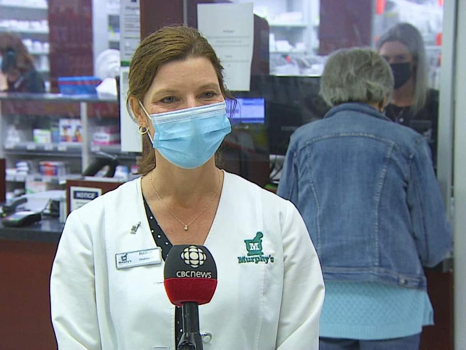 Margie McLane, a pharmacist at Murphy's Pharmacy in Stratford, says there is no need to wait between shots for COVID-19 and the flu. (Shane Hennessey/CBC - image credit)