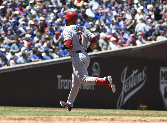 Cincinnati Reds' Eugenio Suarez (7) runs the bases after hitting a three-run home run against the Chicago Cubs during the third inning of a baseball game Saturday, July 7, 2018, in Chicago. (AP Photo/David Banks)