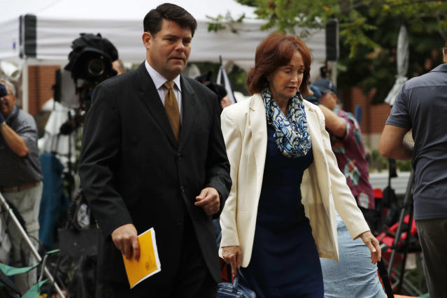 <p>Paul Manafort's wife Kathleen Manafort, right, walks with Manafort spokesman Jason Maloni, to federal court for jury deliberations in the trial of the former Trump campaign chairman, in Alexandria, Va., Tuesday, Aug. 21, 2018. (Photo: Jacquelyn Martin/AP) </p>