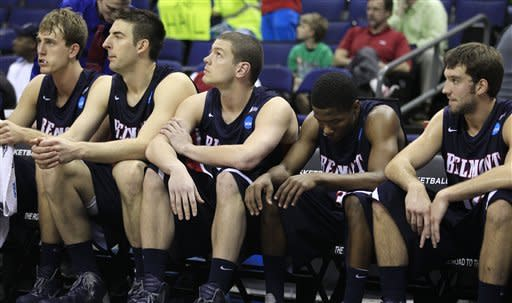 Belmont teammates sit on the bench in the final minutes during the second half of an NCAA men's college basketball tournament second-round game against Georgetown in Columbus, Ohio, Friday, March 16, 2012. Georgetown won 74-59. (AP Photo/Tony Dejak)