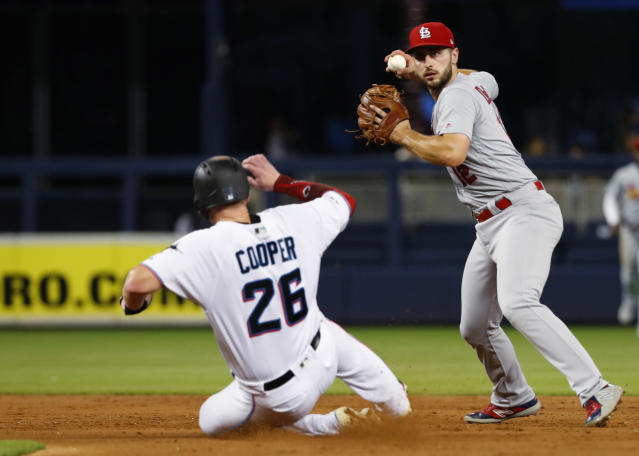 St. Louis Cardinals shortstop Paul DeJong, right, throws to first after forcing out Miami Marlins' Garrett Cooper (26) during the third inning of a baseball game Tuesday, June 11, 2019, in Miami. Brian Anderson was out at first. (AP Photo/Wilfredo Lee)