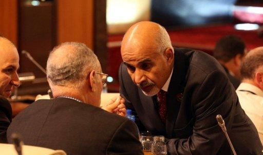 Libya's ruling national assembly picked Mohamed al-Megaryef (R) as its president. Megaryef, born in 1940 in the eastern city of Benghazi, was elected to the GNC under the flag of his grouping, renamed the National Front Party. The poll for leadership of the new congress was broadcast live on Libyan television