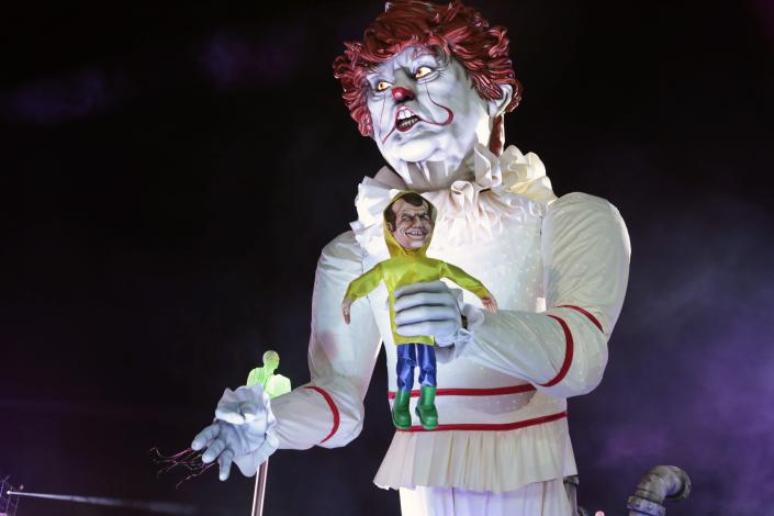 <p>A giant statue of US President Donald Trump depicted as an evil clown holding a French President Emmanuel Macron's puppet in his hand parade during the 135th Nice Carnival on Feb. 16, 2019 in Nice, France (Photo: Patrick Aventurier/Getty Images) </p>