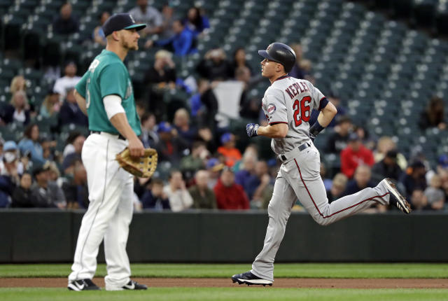 Minnesota Twins' Max Kepler, right, rounds the bases on a home run as Seattle Mariners third baseman Kyle Seager looks away during the fifth inning of a baseball game Friday, May 25, 2018, in Seattle. (AP Photo/Elaine Thompson)