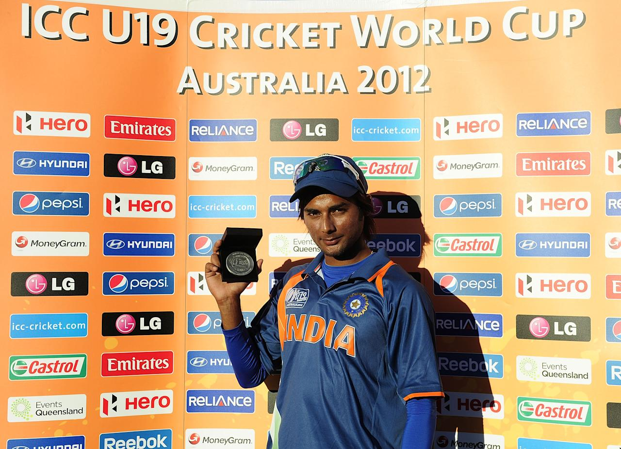 TOWNSVILLE, AUSTRALIA - AUGUST 14:  Kamal Passi of India with the Man of the Match award at the conclusion of the  ICC U19 Cricket World Cup 2012 match between India and Zimbabwe at Tony Ireland Stadium on August 14, 2012 in Townsville, Australia.  (Photo by Ian Hitchcock-ICC/Getty Images)