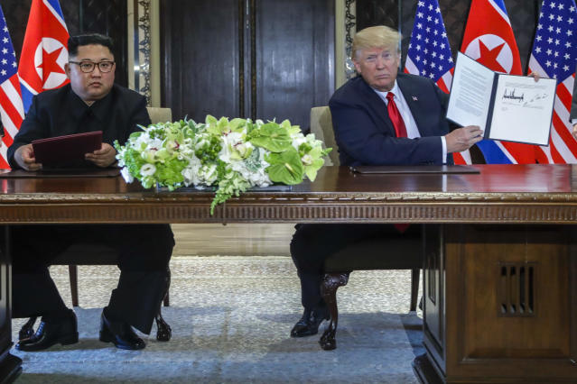 <p>U.S. President Donald Trump holds up the document that he and North Korea leader Kim Jong Un just signed at the Capella resort on Sentosa Island Tuesday, June 12, 2018 in Singapore. The most tangible outcome of the summit between President Donald Trump and North Korean leader Kim Jong Un seems to be a commitment to recover the remains of U.S. military personnel missing in action and presumed dead from the Korean War. In a joint statement signed by the leaders Tuesday, the countries committed to the recovery of the remains and the immediate repatriation of those already identified. (AP Photo/Evan Vucci) </p>