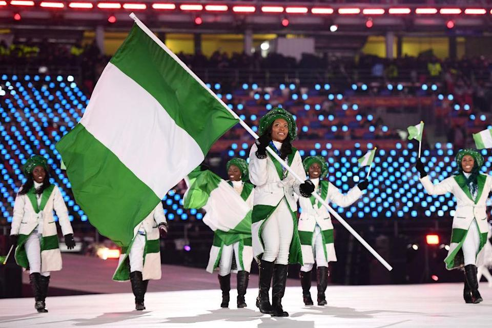 <p>Flag bearer Ngozi Onwumere of Nigeria leads the team wearing chic white coats with green lapels during the opening ceremony of the 2018 PyeongChang Games. (Photo: Quinn Rooney/Getty Images) </p>