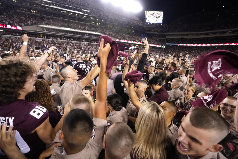 Texas A&M students pack Kyle Field after Texas A&M upset Alabama 38-41 in an NCAA college football game on Saturday, Oct. 9, 2021, in College Station, Texas. (AP Photo/Sam Craft)